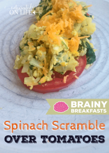 Spinach Scrambled Eggs Served Over Fresh Tomatoes