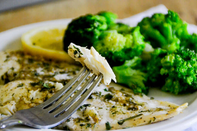 This Easy Baked Fish with Lemon Butter Sauce will have you feeling like a chef from the comfort of your kitchen!